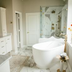 Contemporary White Master Bathroom With Soaking Tub And Glass Shower Enclosure