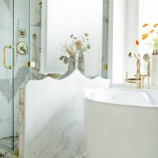 Contemporary White Master Bathroom With Glass Shower And Soaking Tub With Marble Accents