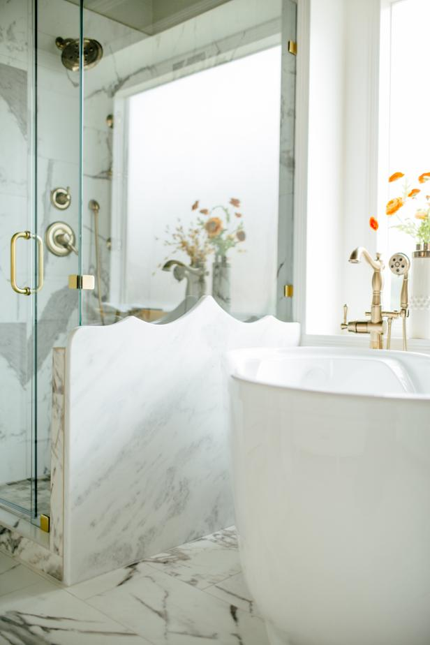 White Master Bathroom With Glass Shower And Tub With Gold Hardware