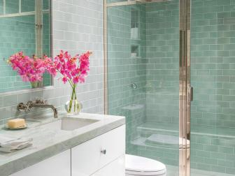 Modern Sea Green Bathroom With Glass Tile And Glass Door Shower