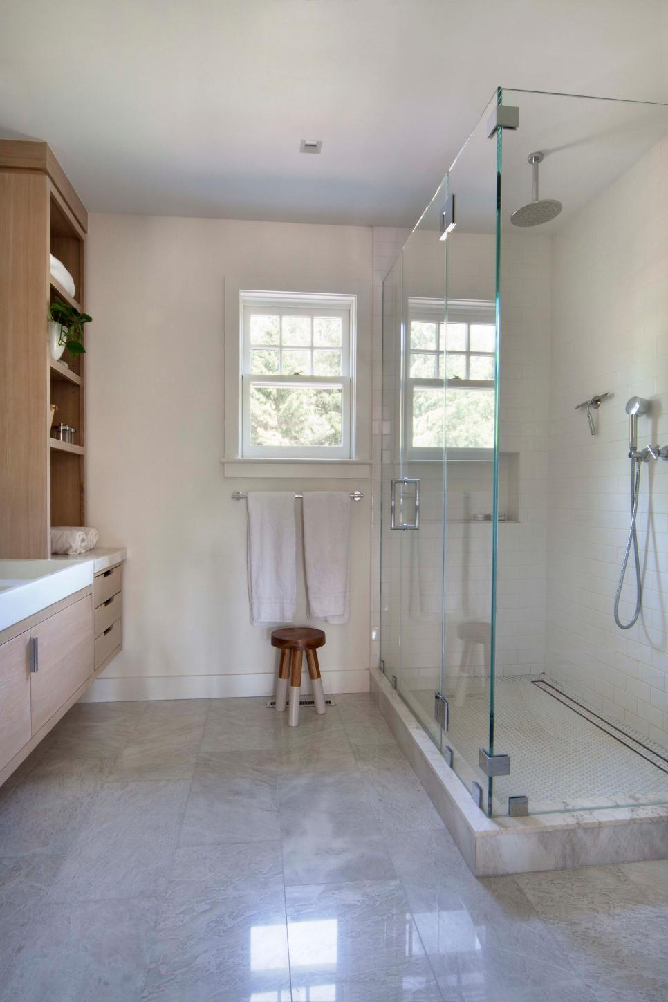 Modern Kids Bathroom With Glass Shower And Marble Tile