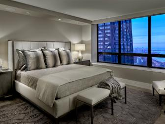 Modern Silver And Gray Master Bedroom With Upholstered Headboard and Contemporary Furnishings