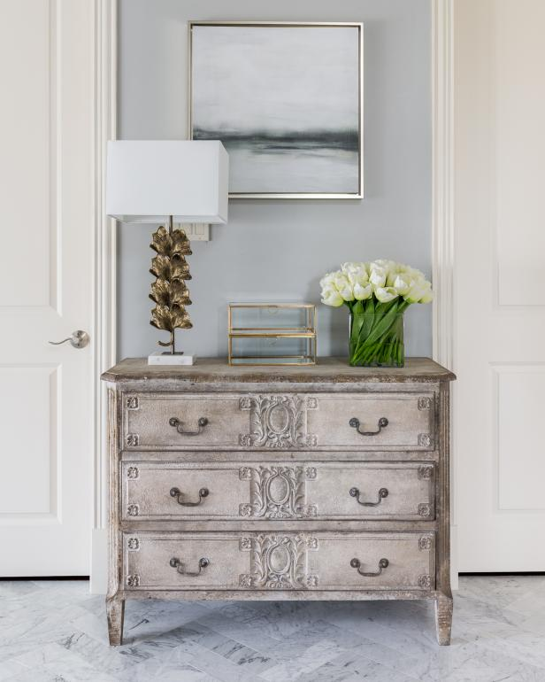 White And Gray Master Bathroom Dresser Detail With Modern Accents
