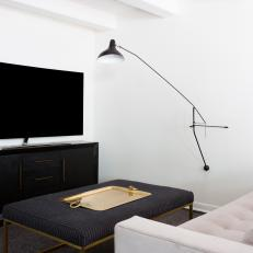 Black and White TV Room With Brass Tray