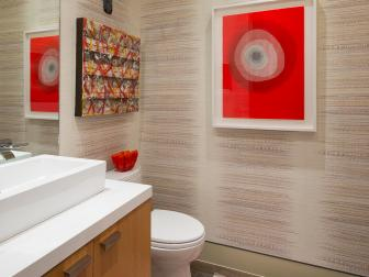 Neutral Powder Room With Red Art