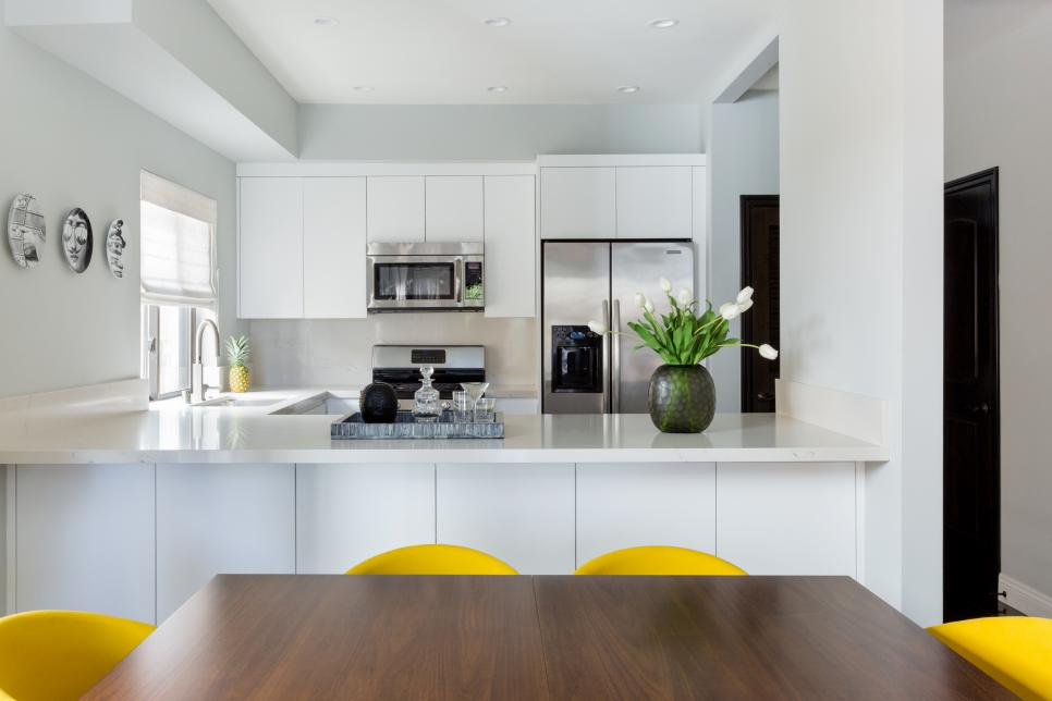 Modern White Kitchen And Dining With Yellow Upholstered Dining Chairs