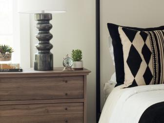 Modern Bedroom Detail With Black And White Accents And Contemporary Bedside Lamp