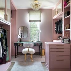 Pink Walk In Closet With Dressing Table