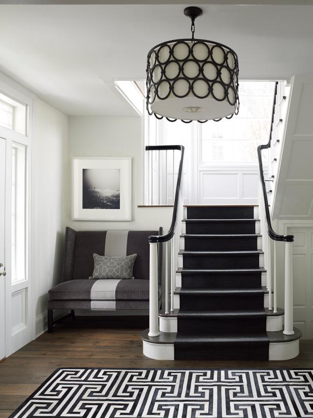 White Entrance With Black And White Accents And Stairs