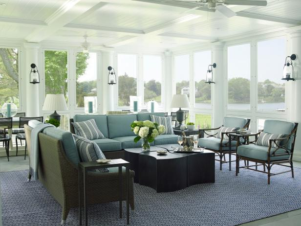 transitional sunroom with blue sofa