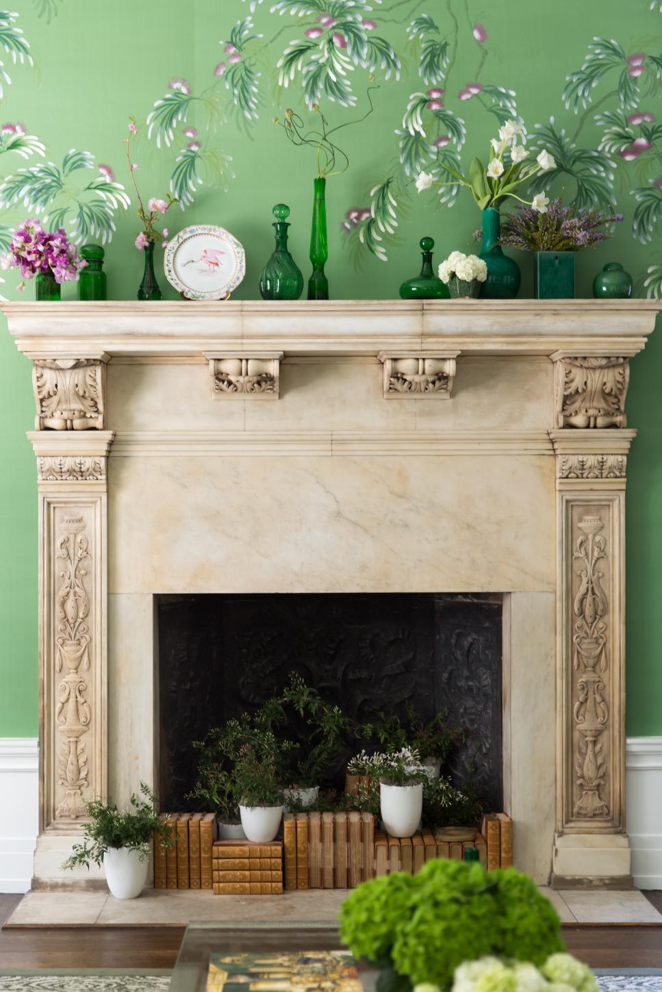 Traditional Fireplace With Antique Accents And Green Wallpaper