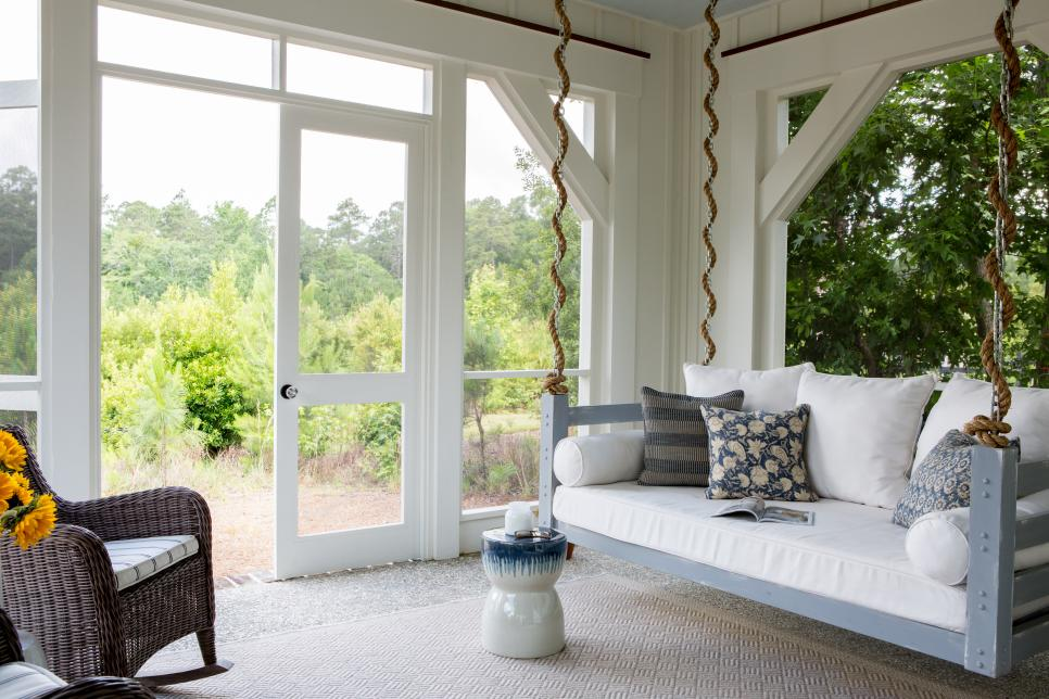 White Cottage Porch With Upholstered Daybed Swing