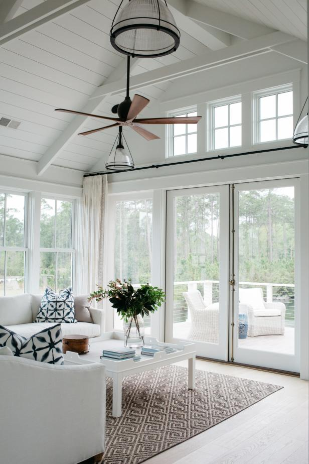 White Cottage Living Room With Exposed Beams And Pendants