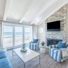Blue and Tan Coastal Living Room With Round Windows