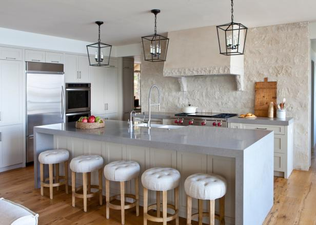 transitional white kitchen with stucco wall