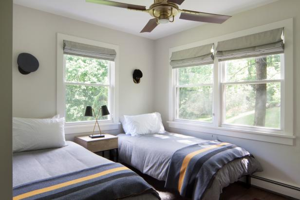 Bedroom With Gray Striped Blankets