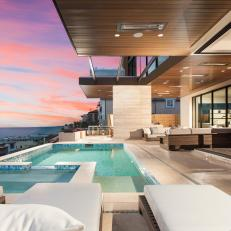 Modern Beachfront Home With Covered Patio With Pool And Outdoor Seating Area