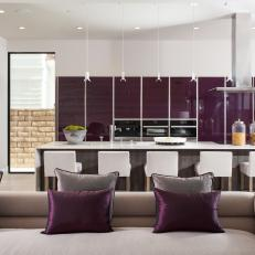 Modern Open Concept Living Room And Kitchen With Purple Accents And Gray Furnishings