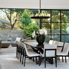 Modern White Dining Room With Steel Window Wall And Contemporary Dining Table And Chairs