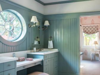 Blue Cottage Kid's Bathroom With Round Window