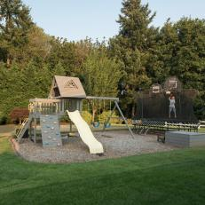 Outdoor Family Play Area With Swing Set And Trampoline