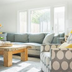 Sectional Pairs Well With Blue Patterned Armchair