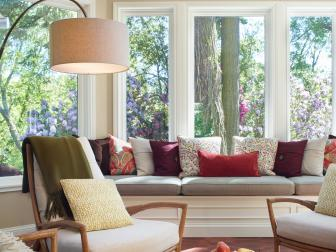 Traditional Sunroom With Built In Window Seat And Midcentury Modern Furnishings