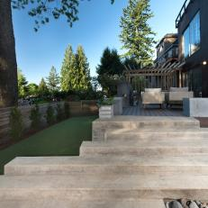 Contemporary Backyard With Concrete Stairs And Wood Deck With Seating
