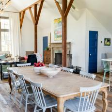 Country-Style Dining Area Set Apart by Wood Beams
