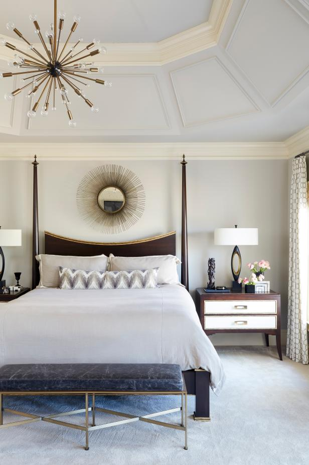 Modern Gray Master Bedroom With Metallic Accents And Tray Ceiling