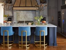 Classic Kitchen With Modern Upholstered Bar Stools And Pendants