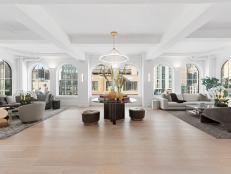 Large Great Room With Arched Windows and Coffered Ceiling