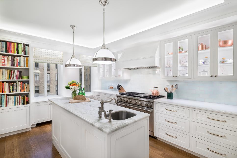 Traditional Kitchen With White Cabinets And Work Island With Sink