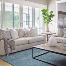 Neutral Living Room Sofa Layered With Patterned Pillows