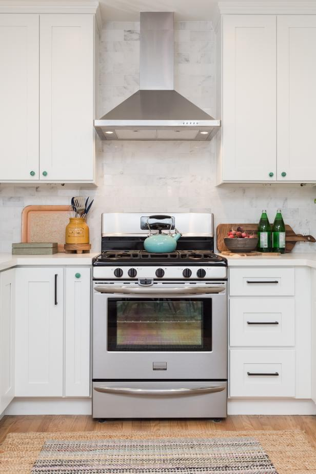 White Kitchen with White Tile Backsplash, Stainless Steel Range Hood