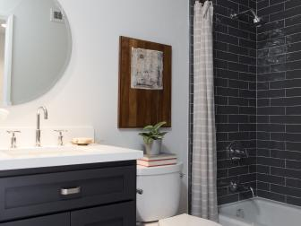 Contemporary Black and White Bathroom with Black Subway Tile Backsplash