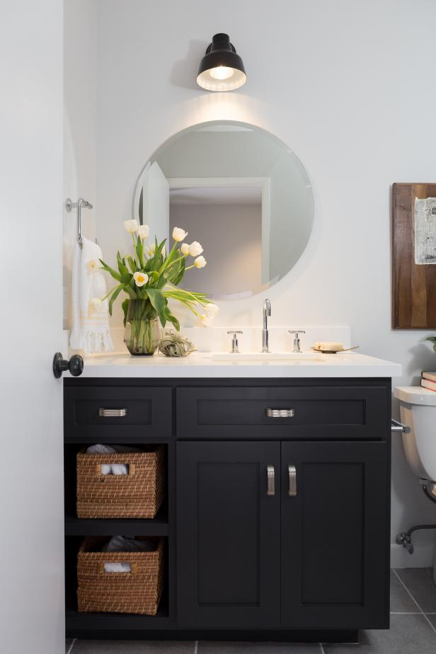 Black and White Bathroom with Black Vanity , White Sink and Mirror