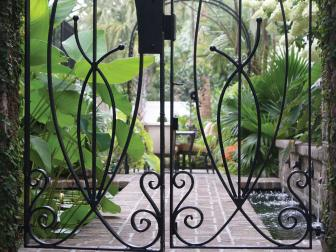 Wrought Iron Gate And Backyard Courtyard