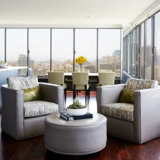Condo Sitting Area With Gray Armchairs