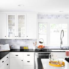 Black and White Chef Kitchen With Gray Backsplash