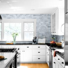 Black and White Open Plan Kitchen With Baguette