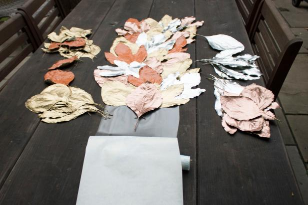 Table runner made of painted leaves.