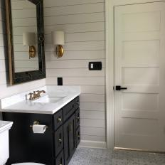 White Shiplap Walls in Black and White Guest Bathroom