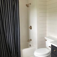 Black and White Pinstripe Shower Curtain Adds Funky Flair to Black and White Guest Bathroom