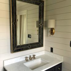 Black Mirror Adds Contrast to Neutral Bathroom While Reflecting Natural Light