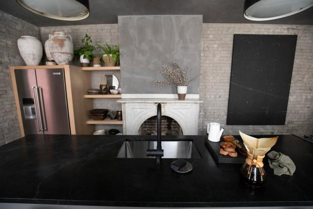 Gray Galley Kitchen with Black Marble Island
