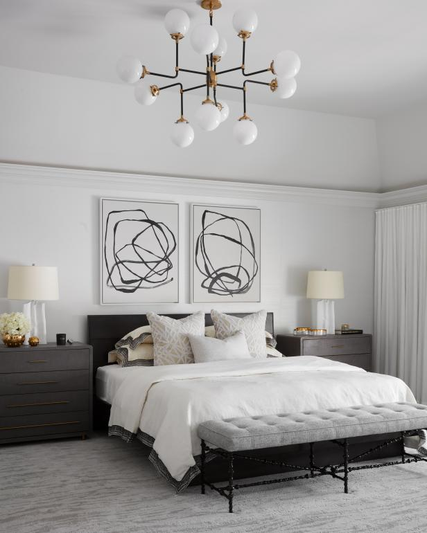 transitional master suite with tufted bench