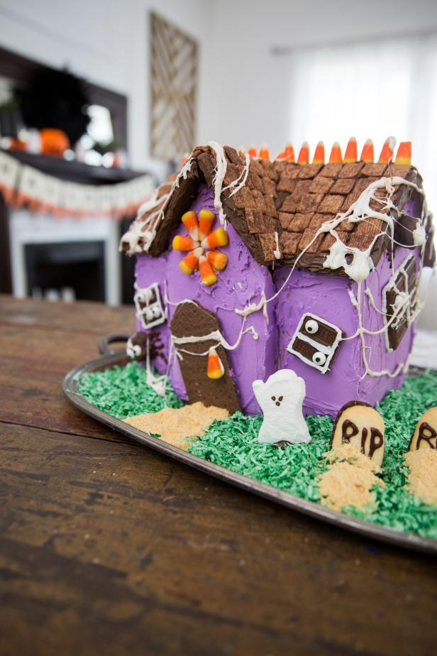 A Halloween Gingerbread House Sitting on a Table