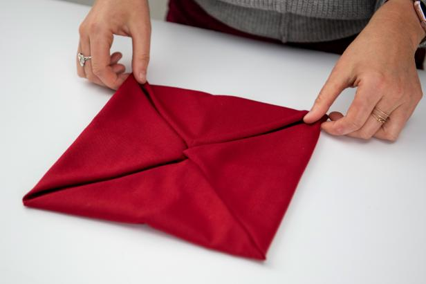 Impress your guests this holiday season with a poinsettia napkin.