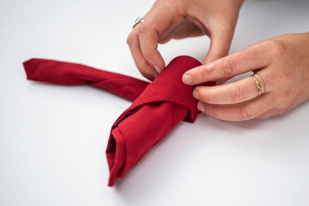 This folded napkin rose is sure to impress your guests this holiday season.